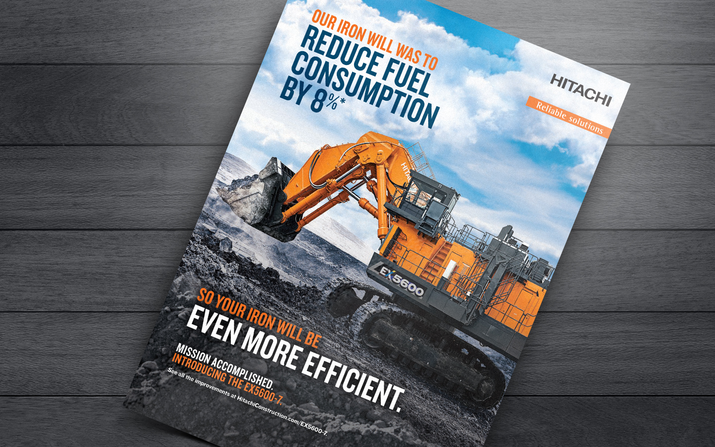 "print ad showing Hitachi mining excavator and text saying ""Our iron will was to reduce fuel consumption by 8%"""