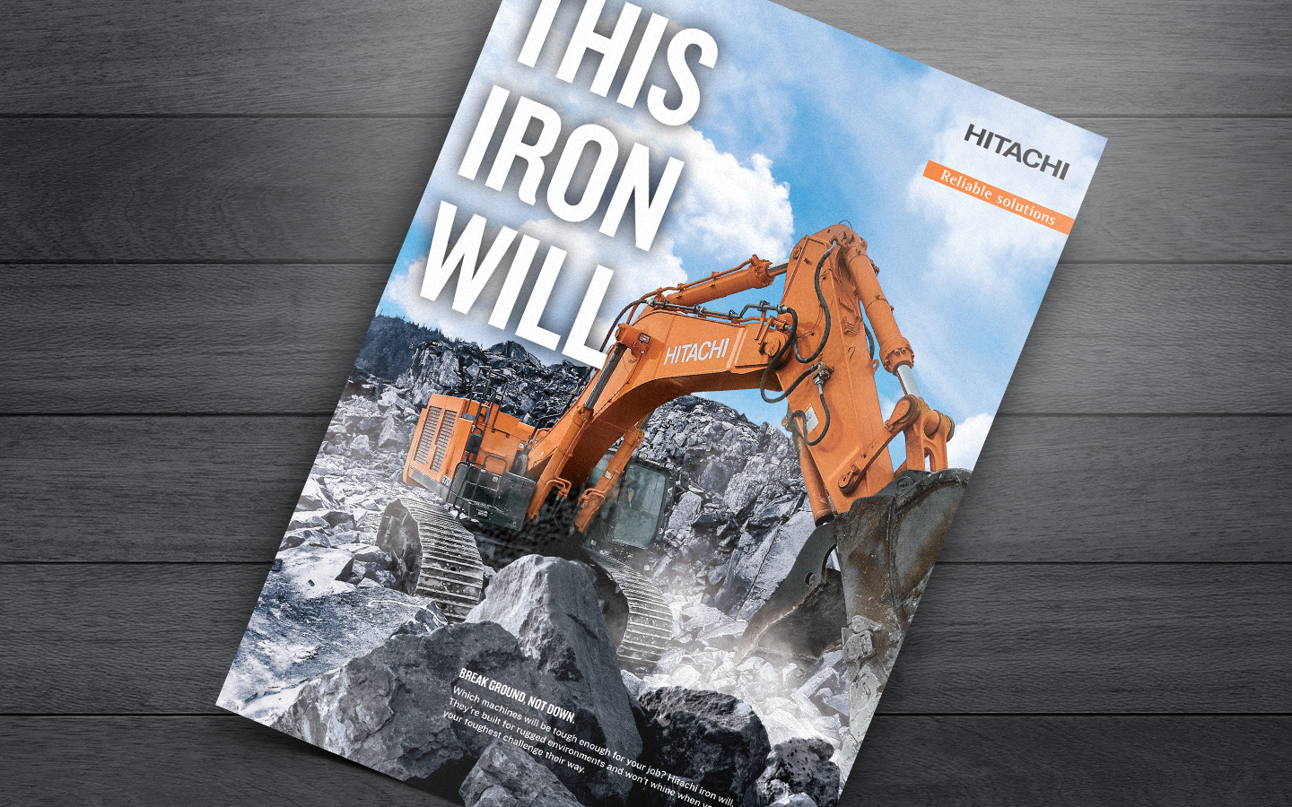 "print ad showing Hitachi excavator and text saying ""This iron will"""