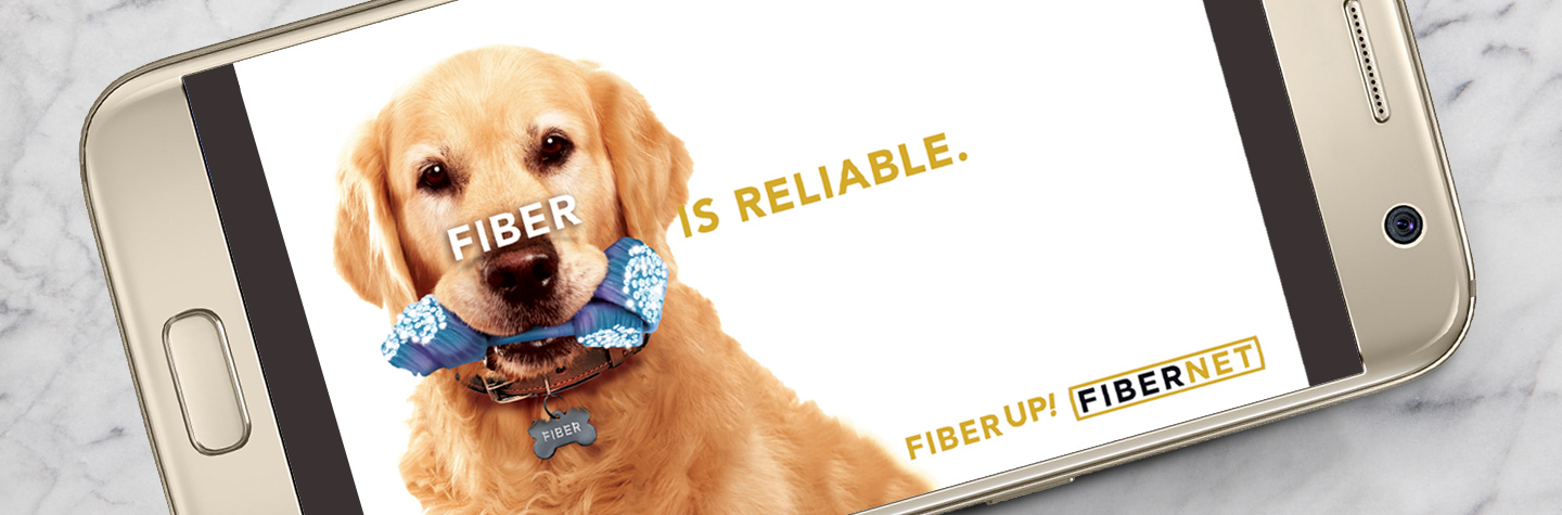 Fiber is Reliable ad shown on a phone with a picture of a dog