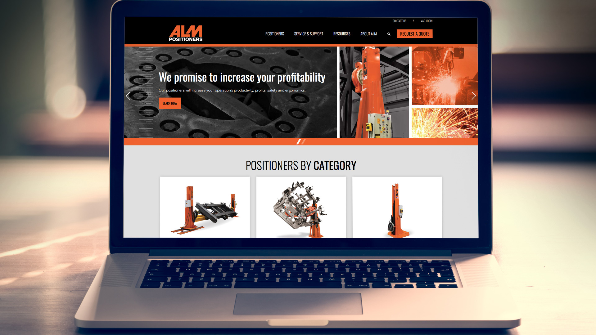 ALM website shown on laptop