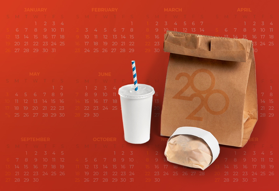 "A takeout ag with ""2020"" on it and a year's calendar behind it"