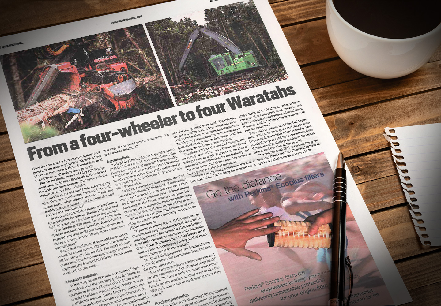 A newspaper on a desk is a Waratah placement in Equipment Journal - the title of the story is From a four-wheeler to four Waratahs