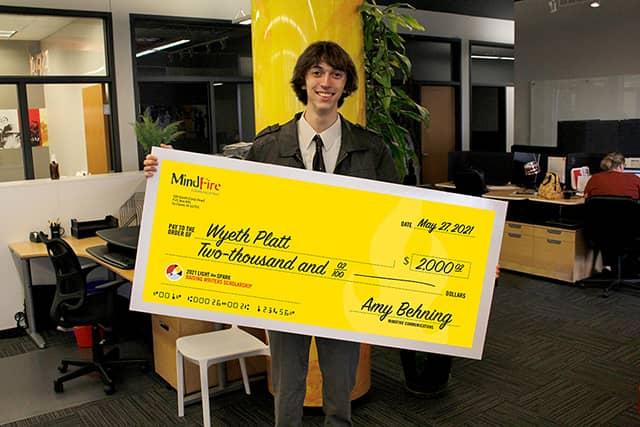 Wyeth Platt holding a scholarship check