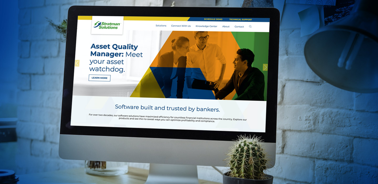 A computer shows the Stratman Solutions website featuring clean, streamlined design