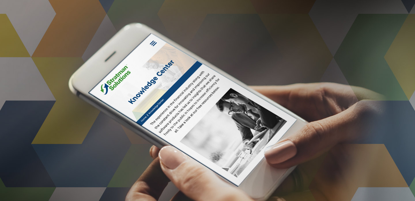 A person looks at the Statman Solutions website's Knowledge Center on their mobile phone
